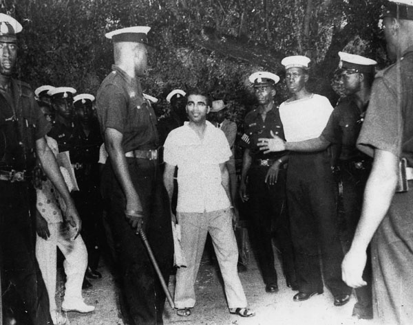 CJ surrounded by police in 1954