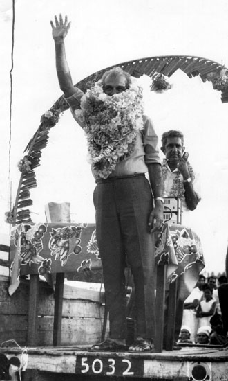 CJ with garlands at PPP meeting